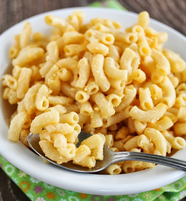 Cooking macaroni-and-cheese without milk is easy and quite similar to cooking it with milk. The same process is followed, except the milk is substituted with replacement ingredient, such butter and water, or sour cream and yogurt for a thick and creamy consistency.